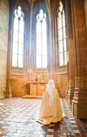 st michel: Sister praying into the Abbey of Mont St. Michel, France Editorial