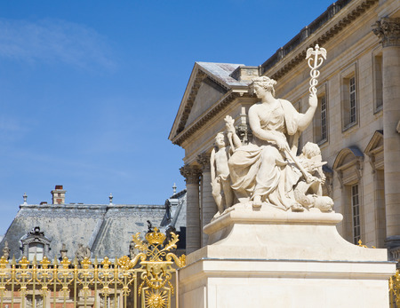chateau: Statue at Versailles Chateau entrance. France
