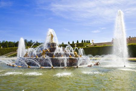 versailles: Latona fountain water spraying in Versailles Chateau gardens. France