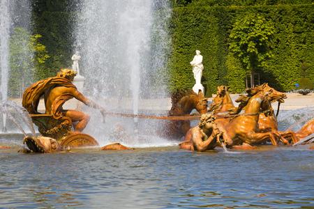 apollo: The Apollo fountain spraying water in Versailles Chateau. France Stock Photo