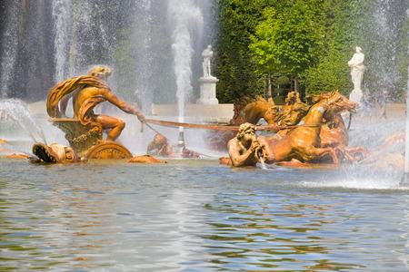 apollo: Apollo fountain spraying water in Versailles Chateau. France Stock Photo