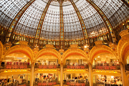 lafayette: Paris, France - July 25, 2009: Interior of Galeries Lafayette. Partial view of shops and Art Nouveau glass dome