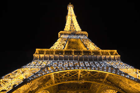 paris night: Paris, France - July 24, 2009: Wide low angle of the Eiffel Tower illuminated at night Editorial