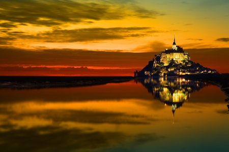 michel: Mont Saint Michel abbaye reflected in the bay at sunset, France Stock Photo