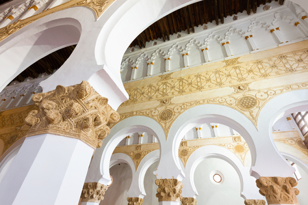 erected: Interior of Santa Maria la Blanca Synagogue in Toledo, Spain. Erected in 1180 and considered the oldest synagogue building in Europe still standing Editorial