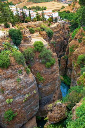 ronda: The Tajo of Ronda is a gorge carved by the Guadalevin river, on which the town sits. Province of Malaga, Spain Stock Photo