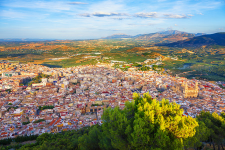 spanish homes: Panoramic of Jaen skyline surrounded by olive groves, Andalusia, Spain. Assumption of the Virgin Cathedral is highlighted by the last rays of sunset Stock Photo