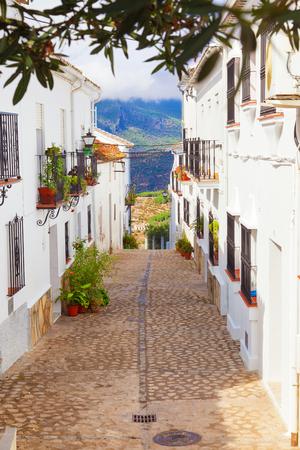 cadiz: Narrow white street of Zahara de la Sierra. Typical white town in the province of Cadiz, Spain Stock Photo