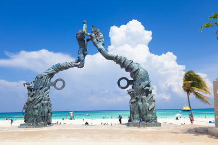 mexico: Playa del Carmen, Mexico - June 28, 2013: Portal Maya, a work of art depicting the history, culture and origins of this city, acting as a window to the sea