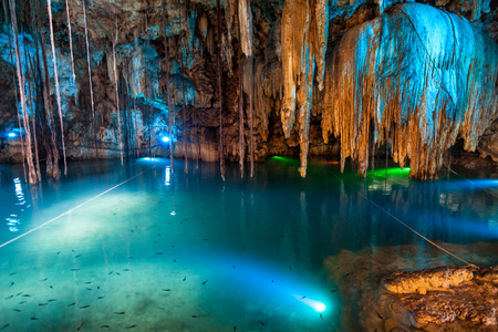Cenote Dzitnup near Valladolid, Mexico. lovely cenote with transparent turquoise waters and large stalactites