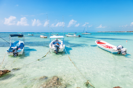 caribbean beach: fishing boats on a Caribbean beach with transparent water