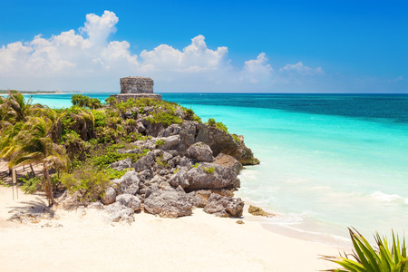 mexico culture: God of Winds Temple on turquoise Caribbean sea. Ancient Mayan ruins in Tulum, Mexico