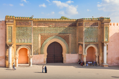declared: Meknes, Morocco - September 17, 2015: Bab Mansour, gate of the old medina in Meknes, Morocco. Unidentified people visible. The old medina of Meknes is declared UNESCO World Heritage Site