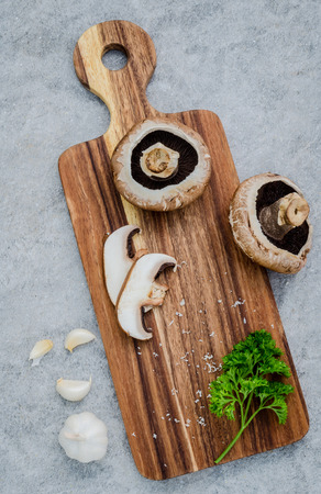 european food: European food concept mushroom soup with champignon mushroom set up with brown background. Stock Photo