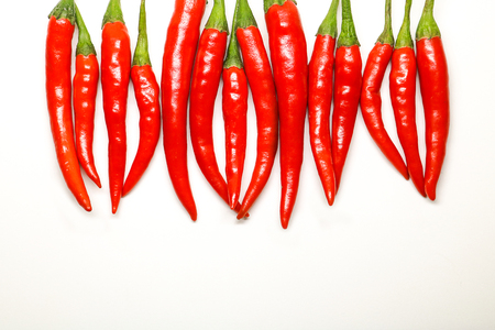 peppery: Red chili peppers on white background. isolated fresh hot chili peppers.
