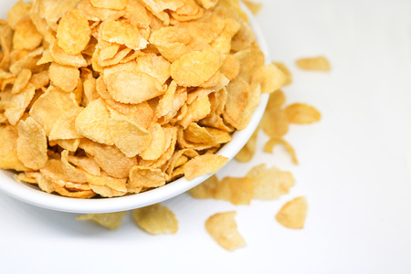 processed grains: Cornflake cereals in a white bowl. Easy breakfast for kids. Quick breakfast. Stock Photo