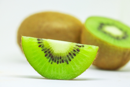 Fresh kiwi fruit isolated on white background. Kiwifruit its health benefits, Boosts Your Immunity, Supports Weight Loss, Helps Clean Out Toxins and Protects the Skin.