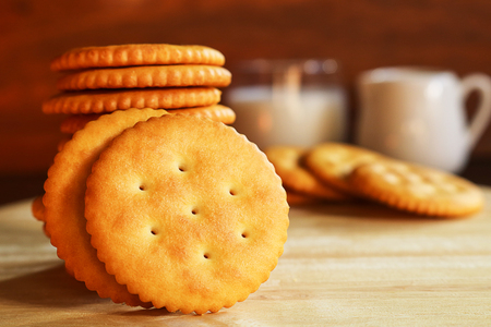 butter biscuits cracker and milk set up on wooden background