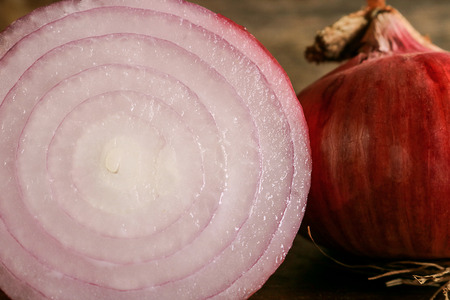 colorectal: fresh red onion on wooden background. Onions are a nutrient-dense food and a lot of health benefits, High fiber, Vitamin C, strong antioxidant and prevention colorectal cancers