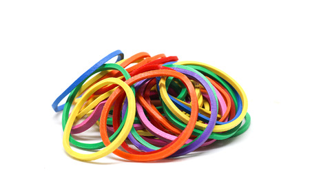 Rubber bands isolated on white background. Elastic bands or gum band made of natural rubber, usually ring shaped, and commonly used to hold multiple objects together.