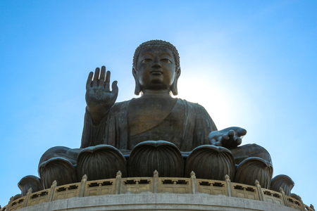 The enormous Tian Tan Buddha at Po Lin Monastery on Lantau Island, Hong Kong. The world's tallest outdoor seated bronze Buddha located in Ngong Ping Village.