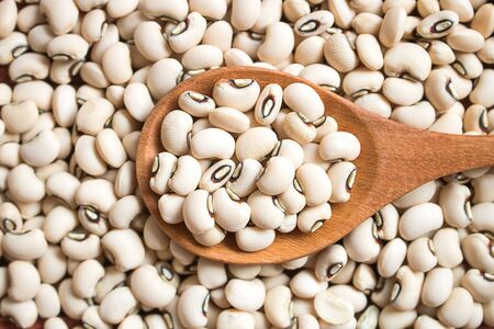 Black eyed beans in wooden  spoon. Black eyed peas has health benefits, Good for helps weight loss and relieving constipation.