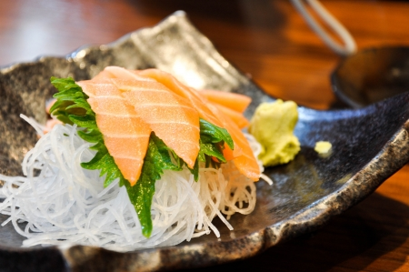 close-up of sashimi salmon served with radish and wasabi photo