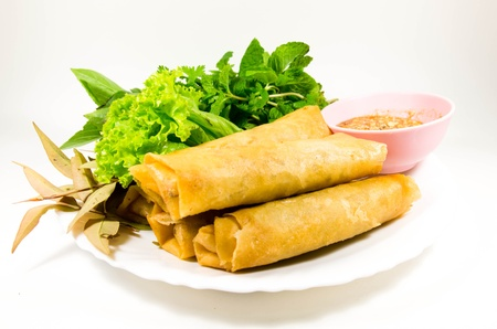 crispy spring rolls on dish with vegetable photo