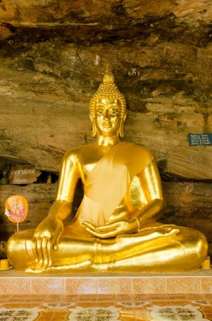 Golden Buddha statue in cave, Ubonratchathani, Thailand photo