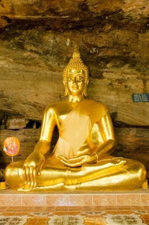 Golden Buddha statue in cave, Ubonratchathani, Thailand Stock Photo - 17338345