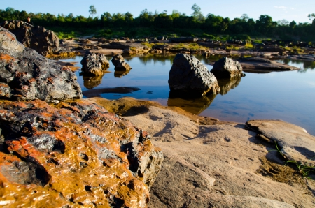 Orange rock and dry river, Sam pan bok, Ubonratchathani, Thailand photo