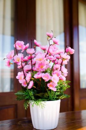 Decorative flower in the white vase Stock Photo - 17386676