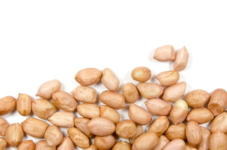 Raw peanuts isolated on white background photo