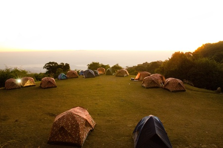 Tents in Huai Nam Dang National park  sitecamp on sunrise and mist sea background