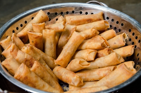 crispy spring rolls on stainless steel colander and dry all of the oil photo
