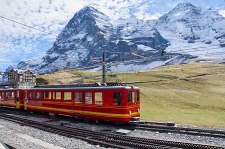 Red Train with Jungfrau Mountain, Switzerland