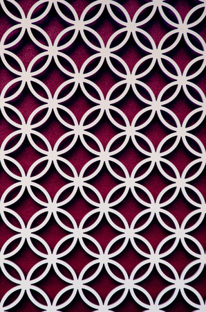 latticework: wood perforated  with Purple color background Stock Photo