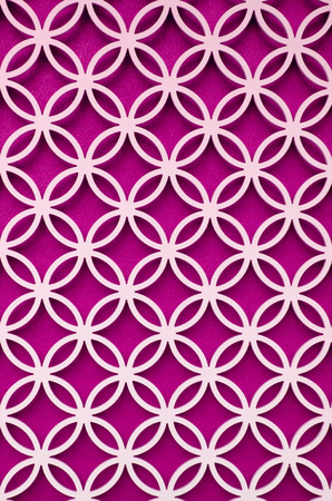 perforated: wood perforated  with Bright Pink color background Stock Photo