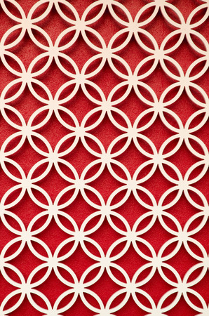 perforated: wood perforated  with Red color background Stock Photo