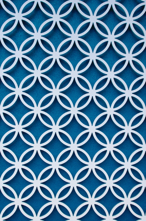 latticework: wood perforated  with Blue color background