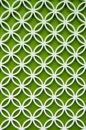 perforated: wood perforated  with Green color background