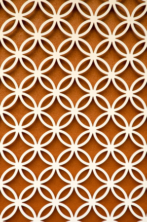 perforated: wood perforated  with brown color background Stock Photo