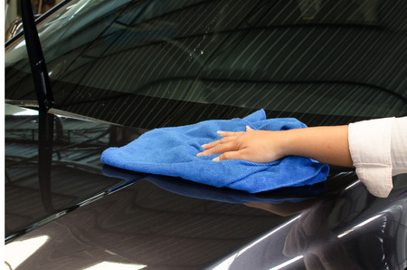 chamois leather: Hand with microfiber cloth wipe car surface
