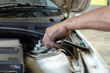 chrome man: Hand with tool in process of car fix Stock Photo