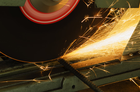 grinder machine: Cut metal with grinder machine, Sparks while grinding iron.