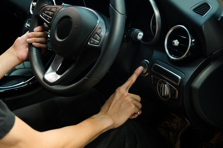 Driver Press Finger On Car's Start Button
