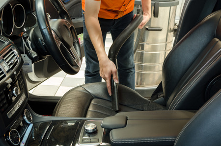 door handle: Cleaning of interior of the car with vacuum cleaner, Car cleaning Stock Photo