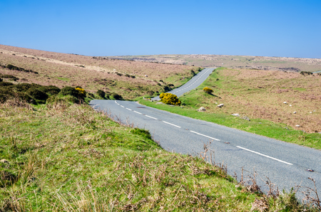 Main Road Of Dartmoor National Park, Area of Moorland In Southern Devon, England, In Spring Season Stock Photo
