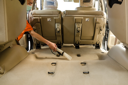 Professional  Cleaning Of Interior Back Seats Carpet SUV Model Cars By Wet Vacuum Machine.