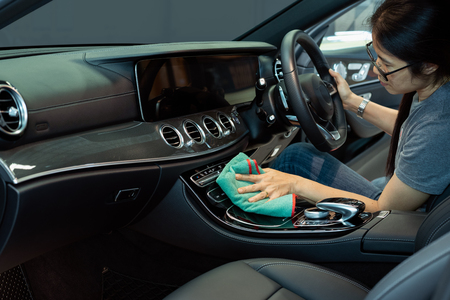 Hand with microfiber cloth cleaning car interior, Fucus  On Hand Stock Photo